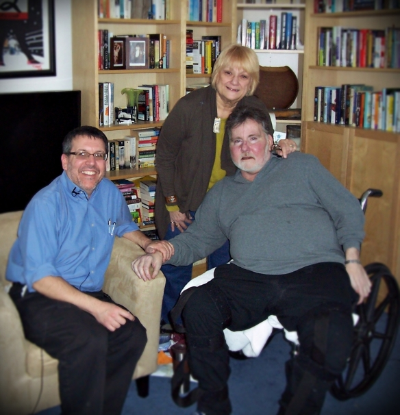 Dr. Goldfine (left) with Randy and Janet Bodoff in their Ventnor, NJ home