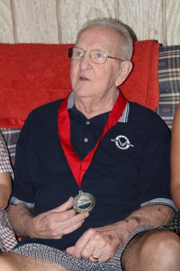 Armando holding his Burlington County Military Service Medal
